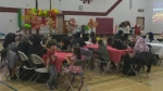 Yazidi, Kurdish and Syrian families gathered at Daniel McIntyre Collegiate Institute to celebrate a new opportunity. (Credit: CTV Winnipeg)