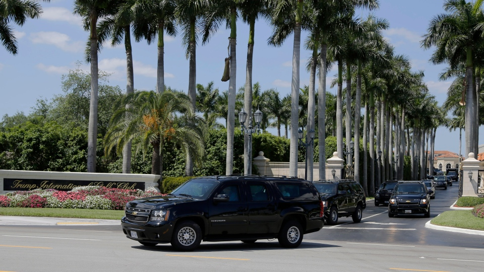 The motorcade carrying President Donald Trump leaves Trump International Golf Club on Saturday, March 23, 2019, in West Palm Beach, Fla. (AP Photo/Terry Renna)