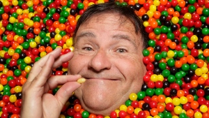 In this Oct. 12, 2011 photo, David Klein, a man who invented the Jelly Belly, poses for photos in Covina, Calif. Klein is the Willie Wonka of this small Los Angeles suburb, joyfully leading children and their parents past mounds of chewy, crunchy, sugary confections with names like Sandy Candy, Zombie Heart and Gummy Bacon. (AP Photo/Jae C. Hong)