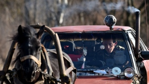 Farmer Alexei Usikov, 31, rides his horse-pulled cart made from an old Audi 80 car in the village of Knyazhitsy, some 230 km east of Minsk. (Sergei GAPON / AFP)