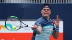 Milos Raonic, of Canada, returns a volley to Kyle Edmund, of Britain, during the Miami Open tennis tournament, Sunday, March 24, 2019, in Miami Gardens, Fla. (AP Photo/Joel Auerbach)