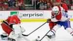 Montreal Canadiens' Phillip Danault (24) tries to score against Carolina Hurricanes goalie Curtis McElhinney (35) while Hurricanes' Dougie Hamilton (19) defends during the second period of an NHL hockey game in Raleigh, N.C., Sunday, March 24, 2019. (AP Photo/Gerry Broome)