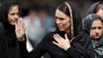 In this Friday, March 22, 2019 file photo, New Zealand Prime Minister Jacinda Ardern, center, waves as she leaves Friday prayers at Hagley Park in Christchurch, New Zealand.(AP Photo/Vincent Thian, File)