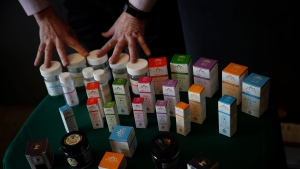 In this Feb. 19, 2019 photo, a vendor shows various cannabis products to retired seniors at Bud and Bloom cannabis dispensary in Santa Ana, Calif. (AP Photo/Jae C. Hong)