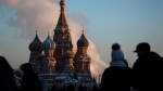 In this Thursday, Jan. 24, 2019 file photo, people walk in Red Square on a cold day, with St. Basil's Cathedral in the background, in Moscow, Russia. A senior Russian lawmaker on Monday March 25, 2019, has welcomed the findings of special counsel Robert Mueller's report on Russian involvement in the U.S. presidential election, saying this gives the countries a chance to mend ties. (AP Photo/Pavel Golovkin, File)