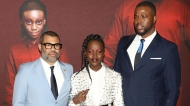 """Director Jordan Peele, from left, Lupita Nyong'o and Winston Duke attend the premiere of """"Us"""" at the Museum of Modern Art on Tuesday, March 19, 2019, in New York. (Photo by Greg Allen/Invision/AP)"""
