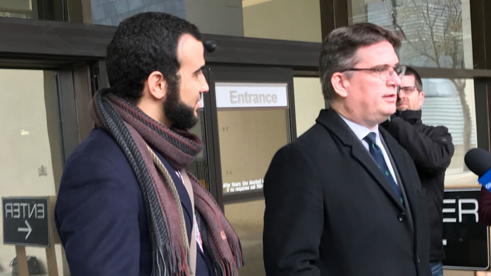 Omar Khadr and his lawyer speaks to reporters after a judge ruled in his favour that his war crimes sentence has expired. (CTV News / Bill Fortier)