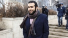 Former Guantanamo Bay prisoner Omar Khadr leaves court in Edmonton on Monday March 25, 2019. A judge ruled Monday that Omar Khadr has completed his sentence. THE CANADIAN PRESS/Jason Franson