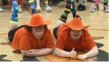 A pair of friends with Down syndrome celebrate their differences with nearly 100 fellow students.