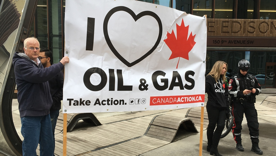 Pro-energy protesters rallied outside a Calgary hotel where the finance minister was speaking on Monday.