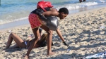 Joshua Caraway is seen picking up garbage on Miami Beach on March 23, 2019. (Credit: Joel Franco/WSVN)