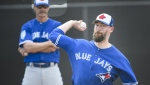 Toronto Blue Jays pitcher John Axford, right, throws a bullpen session as Blue Jays pitching coach Pete Walker looks on during baseball spring training in Dunedin, Fla., on Wednesday, February 20, 2019. THE CANADIAN PRESS/Nathan Denette
