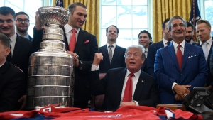 U.S. President Donald Trump, center, hosts the 2018 Stanley Cup Champion Washington Capitals hockey team in the Oval Office of the White House in Washington, Monday, March 25, 2019. (AP Photo/Susan Walsh)