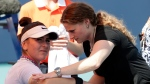 Bianca Andreescu, left, of Canada, receives medical treatment from Lisa Pataky, of the WTA, during her match against Anett Kontaveit, of Estonia, during the Miami Open tennis tournament, Monday, March 25, 2019, in Miami Gardens, Fla. (AP Photo/Lynne Sladky)