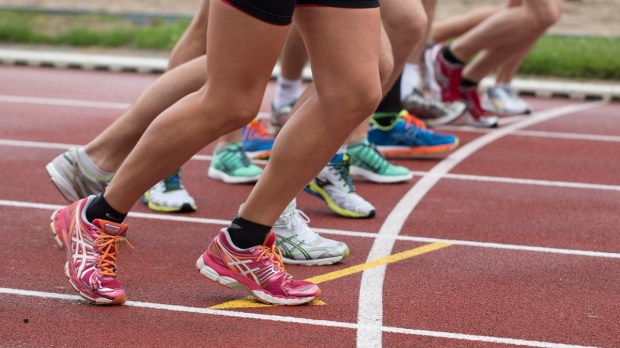Track runners are seen in this file image. (Pexels)