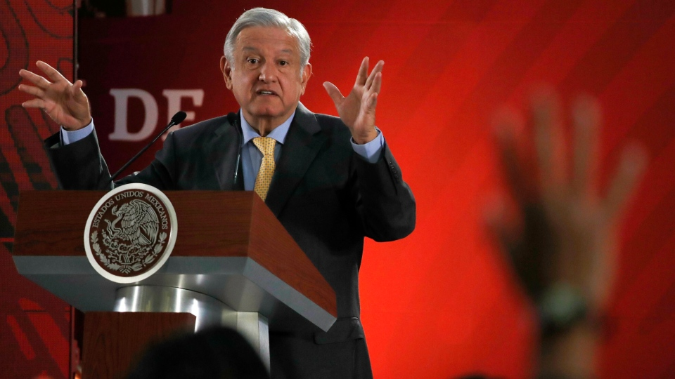FILE - In this Friday, March 8, 2019 file photo, Mexican President Andres Manuel Lopez Obrador answers questions from journalists at his daily 7 a.m. press conference at the National Palace in Mexico City. (AP Photo/Marco Ugarte, File)