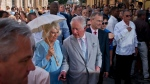 Britain's Prince Charles, the Prince of Wales, center, and his wife Camilla, Duchess of Cornwall, take a guided tour of the historical area of Havana, Cuba, Monday, March 25, 2019.  (AP Photo/Ramon Espinosa)