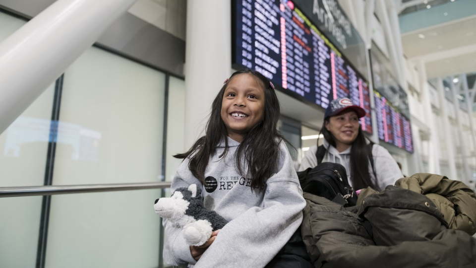 Vanessa Rodel and her seven-year-old daughter Keana leave Lester B. Pearson Airport in Toronto on Monday, March 25, 2019. (THE CANADIAN PRESS/Christopher Katsarov)