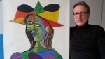 "This image released on Tuesday March 26, 2019 by Arthur Brand, shows Dutch art detective Arthur Brand with ""Buste de Femme"", a recovered Picasso painting. (Arthur Brand via AP)"