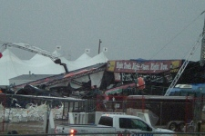 The stage collapsed under the fierce winds of a sudden storm, killing one and injuring at least 15.