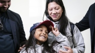Vanessa Rodel and her seven-year-old daughter Keana talk to media after arriving at Lester B. Pearson Airport in Toronto, on Monday, March 25, 2019. THE CANADIAN PRESS/Christopher Katsarov