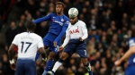 Chelsea's Callum Hudson-Odoi, left, and Tottenham's Danny Rose challenge for the ball during the English League Cup semifinal first leg soccer match between Tottenham Hotspur and Chelsea at Wembley Stadium in London, Tuesday, Jan. 8, 2019. (AP Photo/Frank Augstein)