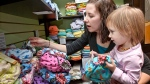 In this Feb. 5, 2009 photo, Heather Krupa and her 19-month-old daughter Madeline shop for cloth diapers  (AP Photo/Nati Harnik)