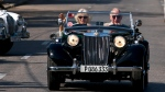 Prince Charles drives a vintage car with his wife Camilla, Duchess of Cornwall, during a cultural event in Havana, Cuba, Tuesday, March 26, 2019. (AP Photo/Ramon Espinosa)