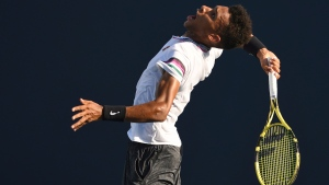 Felix Auger-Aliassime, of Canada, serves during the Miami Open tennis tournament Sunday, March 24, 2019, in Miami Gardens, Fla. (AP Photo/Jim Rassol)