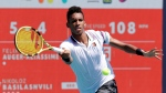 Felix Auger-Aliassime, of Montreal, returns to Nikoloz Basilashvili, of Georgia, during the Miami Open tennis tournament, Tuesday, March 26, 2019, in Miami Gardens, Fla. (AP Photo/Lynne Sladky)
