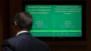 Members of the House of Commons Standing Committee on Access to Information, Privacy and Ethics arrive for a meeting on Parliament Hill in Ottawa, Tuesday, March 26, 2019. THE CANADIAN PRESS/Adrian Wyld