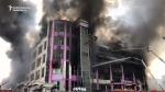 Five-story shopping mall bursts into flames