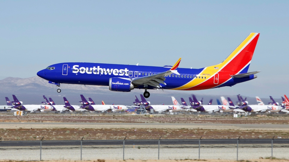 In this March 23, 2019, photo, a Southwest Airlines Boeing 737 Max aircraft lands at the Southern California Logistics Airport in the high desert town of Victorville, Calif.  (AP Photo/Matt Hartman)