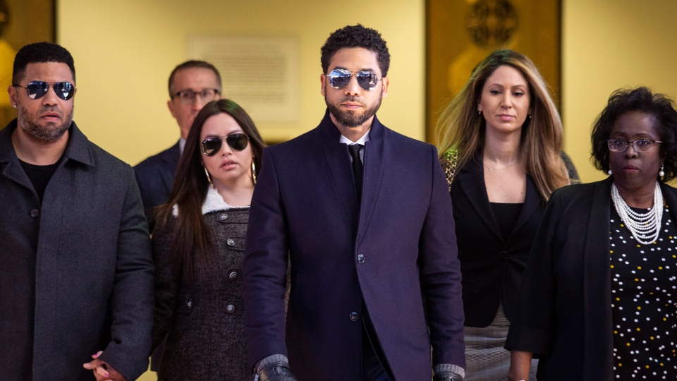 Actor Jussie Smollett, center, leaves the Leighton Criminal Courthouse in Chicago after prosecutors dropped all charges against him on Tuesday, March 26, 2019. (Ashlee Rezin/Sun-Times/Chicago Sun-Times via AP)