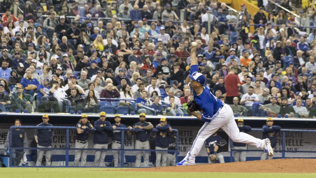 Toronto Blue Jays' Javy Guerra delivers a pitch