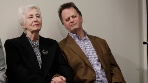 Edwin Hardeman, right, sits with his wife Mary at a news conference in San Francisco, Wednesday, March 27, 2019. (AP Photo/Jeff Chiu)
