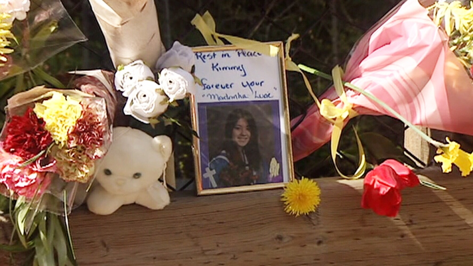 A memorial for Kimberly Proctor is shown in an undated image from video.