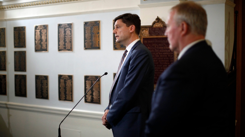 B.C. Attorney General David Eby and Federal Minister of Border Security and Organized Crime Reduction Bill Blair speak to media following a meeting to discuss money laundering during a press conference at Legislature on Wednesday, March 27, 2019. THE CANADIAN PRESS/Chad Hipolito
