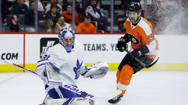 e3c9fec456d Toronto Maple Leafs' Frederik Andersen, left, blocks a shot as Philadelphia  Flyers' James van Riemsdyk looks for rebound during the second period of an  NHL ...