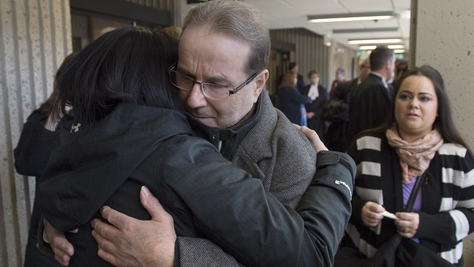 Glen Assoun is embraced by family members at Nova Scotia Supreme Court in Halifax on March 1, 2019. THE CANADIAN PRESS/Andrew Vaughan
