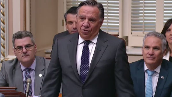 Quebec Premier Francois Legault speaks in the National Assembly on Thurs., March 28, 2019 as his Coalition Avenir Quebec government tables a bill that would ban public employees in positions of authority from wearing religious symbols.