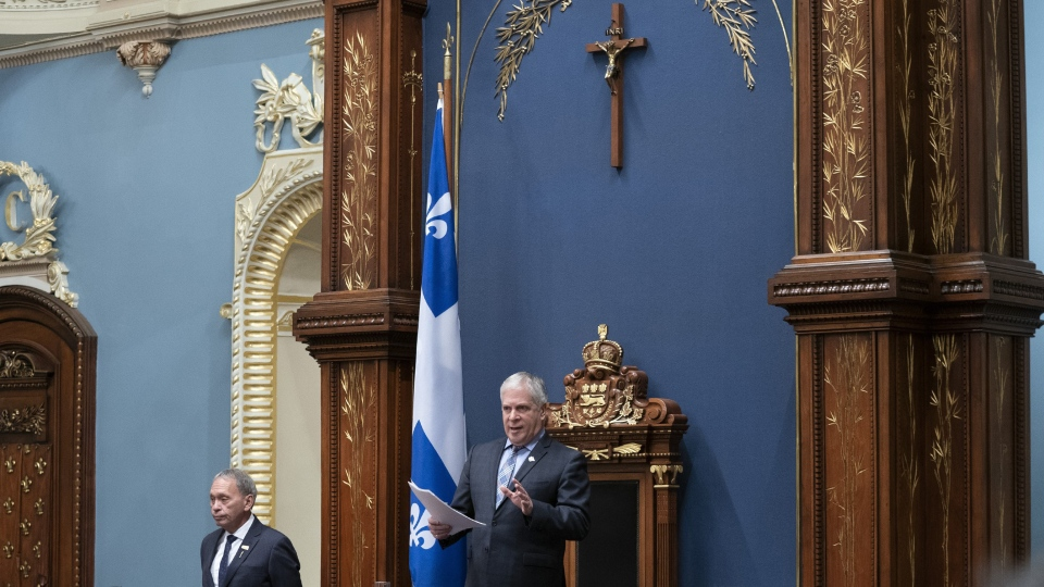 Quebec National Assembly Speaker Francois Paradis speaks during question period Thursday, March 28, 2019 at the legislature in Quebec City. Also visible is the crucifix that has hung over the speaker's chair for more than 80 years. (THE CANADIAN PRESS / Jacques Boissinot)