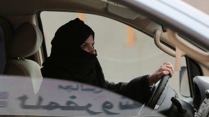 FILE - In this March 29, 2014 file photo, Aziza al-Yousef drives a car on a highway in Riyadh, Saudi Arabia, as part of a campaign to defy Saudi Arabia's then ban on women driving. (AP Photo/Hasan Jamali, File)