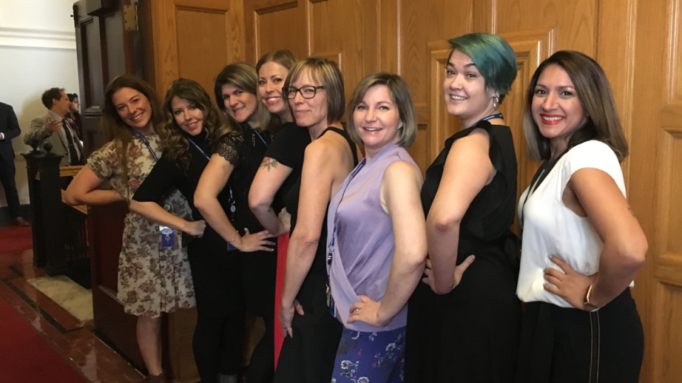 CTV's Bhinder Sajan, right to left, Shannon Waters, Liza Yuzda, Justine Hunter, Jen Holmwood, Katie DeRosa, Tanya Fletcher and Kylie Stanton pose for a photo at the B.C. Legislature in Victoria on Thursday, March 28, 2019. (THE CANADIAN PRESS/Dirk Meissner)