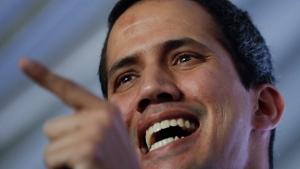 Venezuela's self-proclaimed interim president Juan Guaido talks during a meeting with electricity experts in Caracas, Venezuela, Thursday, March 28, 2019. (AP Photo/Natacha Pisarenko)
