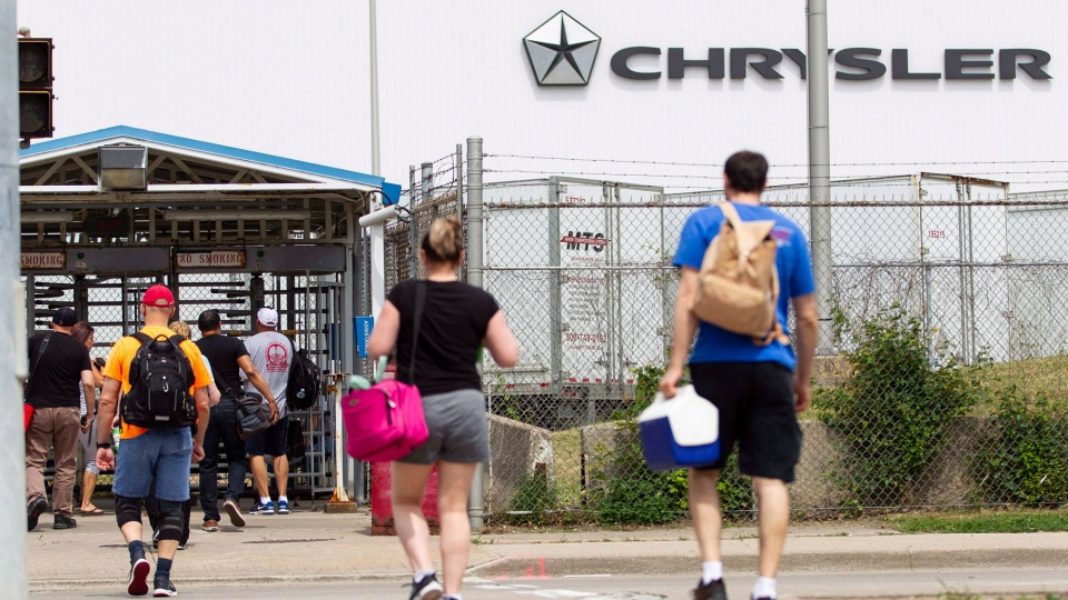Workers arrive for their shift at the Chrysler (FCA) assembly plant in Windsor, Ont., on Tuesday, June 12, 2018. THE CANADIAN PRESS/Geoff Robins