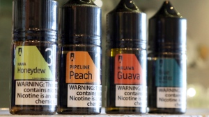 This Wednesday, March 27, 2019 photo shows a selection of e-liquid flavors like Hana Honeydew and Pipeline Peach on a counter at a VOLCANO Fine Electronic Cigarettes store in Aiea, Hawaii. (AP Photo/Audrey McAvoy)