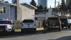 RCMP officers respond to an undisclosed incident in the Central City area of Surrey on March 29, 2019.