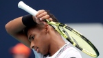 Felix Auger-Aliassime, of Canada, reacts during his semifinal match against John Isner at the Miami Open tennis tournament, Friday, March 29, 2019, in Miami Gardens, Fla. (AP Photo/Lynne Sladky)