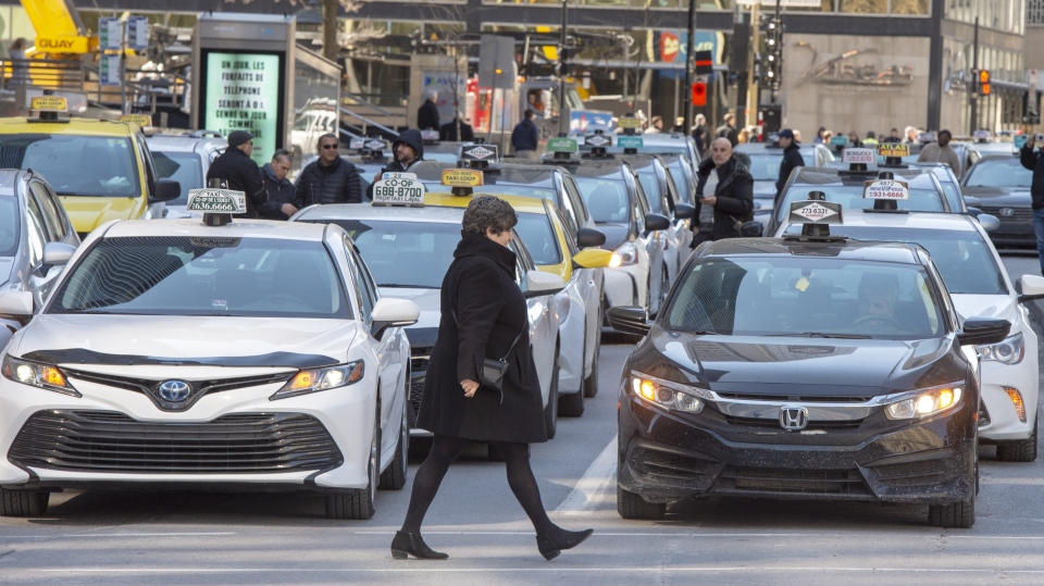 Taxi drivers take part in a one day strike to protest new government regulations in Montreal on Monday, March 25, 2019. THE CANADIAN PRESS/Ryan Remiorz
